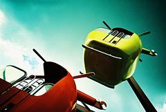 Lomo – get to the chopper (lomomowlem) Tags: 35mm analogue crossprocess colourstreambrighton amusementpark expiredfilm helicopter kodakelitechrome lomo lomography lca lofi xpro xprocess peppapigworld clouds