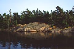 across the channel (.grux.) Tags: zeissikon ercona1 folder tessartcoated105mmf35 6x9 mediumformat 120 film fujivelvia50 expiredfilm channel water island rock trees settingsun georgianbay