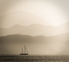 Sailing Away (Matthew Bickham) Tags: corfu sea boat sailing mountains greece sun sepia sky