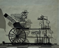 street art in Georgetown (SM Tham) Tags: asia southeastasia malaysia penang island georgetown unescoworldheritagesite cannonstreet streetart artinstallation building wall shadows lady hole pavement rickshaw wheel wire sculpture