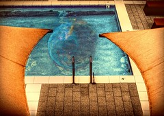 Renewal Through Water (clarkcg photography) Tags: pool water tile steps ladder umbrellas loungechair world afresh reboot clean cleanse purify splash swim dive modified altered changedup addedto layered layers sliderssunday