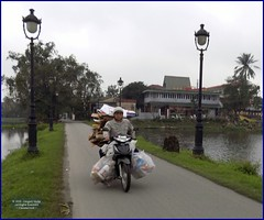 Vietnam, Hue City Loaded 20180212_153859 DSCN3135 (CanadaGood) Tags: asia asean seasia vietnam vietnamese hue building lake motorcycle people person canadagood 2018 thisdecade color colour