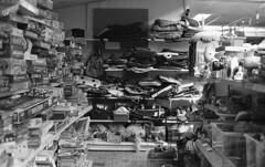 Thrift galore (Arne Kuilman) Tags: kosmofoto kosmofotomono iso100 contax zeiss 50mm 50mmf17 slr film homedeveloped pyrocathd 11minutes developed developer netherlands nederland ijmuiden thriftstore kringloopwinkel