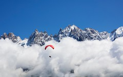 High Flyer (Kevin.Grace) Tags: chamonix france parachute glider clouds mountains paraglider
