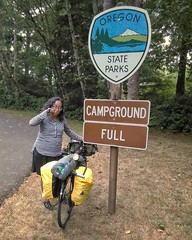 From last night: Oh no, Cape Lookout is full, what shall we do? Oh wait, we're on bikes so that sign doesn't apply to us. #smugnotsmug #shawnandemeeorcoasttouraug2018 #biketour #biketouring  Emee Pumarega (urbanadventureleaguepdx) Tags: biketouring biketour shawnandemeeorcoasttouraug2018 smugnotsmug