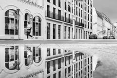 Secondworld (Zesk MF) Tags: bw black white street woman walking mirroring spiegelung reflection water wasser puddle mono zesk building architecture