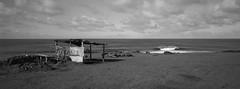 Shelter, Easter Island (austin granger) Tags: shelter easterisland rapanui wave shore aluminum evidence bottle film xpan