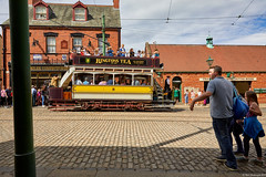 Beamish tram in victorian town (neilgcart) Tags: beamish england unitedkingdom gb countydurham europe worldregionscountries architecture building categories city historicalbuilding streetscene tram transportation 2018leamside events holiday people social