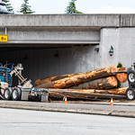Everett, Washington, USA - June 25, 2018. Police officers inspect a logging truck accident. thumbnail