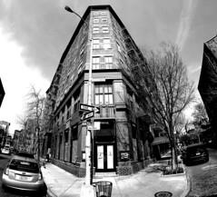 Bank Street Corner - Greenwich Village (MassiveKontent) Tags: streetphotography bwphotography streetshot architecture geometric lines symmetry building bw contrast city monochrome urban blackandwhite streetphoto manhattan shadows nyc newyorkcity walkway street road newyorkstreet newyorkcitystreet newyork midtown metropolis metropolitan america cityscape gopro fisheye corner greenwichvillage noiretblanc
