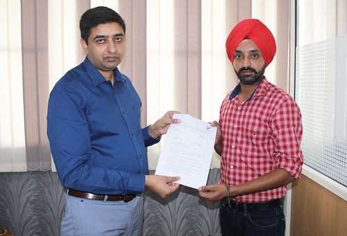 Mr. Gurvinder Kang (Director of West Highlander) handing over New Zealand Dependent Visitor Visa to Jaspreet Singh