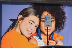 Gt. Portland St. 2aug18 (richardbw9) Tags: london uk city street urban streetshot streetphoto streetphotography westminster greatportlandstreet fitzrovia missselfridge sign parking block poster ad pointofsale marketing orange fashion oxfordcircus oxfordstreet