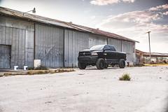 Ram 2500 (Kolin Toney) Tags: dodge ram 2500 diesel black truck car vehicle automobile automotive warehouse ware house barn shed rust metal work pavement golden hour sunset sun set