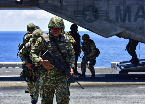Royal Malaysian marines embark the USS Essex during CARAT 2018