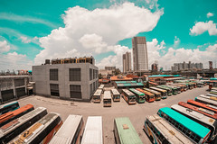Bus Perspective (AllanAnovaPhotos) Tags: muntinlupa alabang starmall clouds bus buses houses perspective fisheye fisheyelens samyang rokinon 8mm philippines