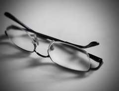 a cheap pair of reading glasses (j0035001-2) Tags: singapore bw monochrome spectacles glasses blur simple simplicity