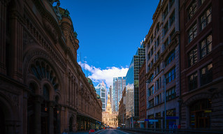 Street in sydney city with church background