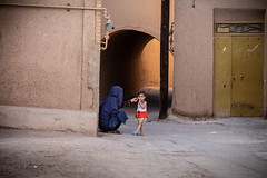 Some traditions have to change (The eclectic Oneironaut) Tags: 2018 6d canon eos iran selected travel viajes yazd women kids mud yazdprovince irán ir