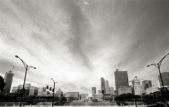 Skyline (johnlishamer.com) Tags: 2018 35mm buckinghamfountain grantpark ilfordfp4125 lakemichagan lishamer nikonf3 slr chicagoil family film johnlishamercom rodinal skyline summer