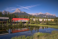 Canmore, Alberta (Margarita Genkova) Tags: red colours landscape train reflection green river mountain rockymountains alberta canmore