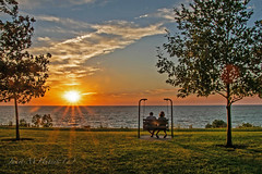 Lake Erie Sunset (jmhutnik) Tags: lake ohio lakeerie willowick sunset goldenhour trees park clouds swing summer july grass wter