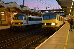 Greater Anglia 90008 on the left at Ipswich with the 2030 service from London Liverpool Street to Norwich and on the right 90011 rolls in with the 2100 Norwich to Liverpool Street. 23 06 2018 (pnb511) Tags: greateranglia trains railway ipswich greateasternmainline geml class90 track station platform canopy footbridge electric overhead cable ohc catenary traction loco locomotive