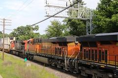 CN rides along with the BNSF (kschmidt626) Tags: union pacific train illinois rochelle park railroad graffiti bnsf burlington diamond