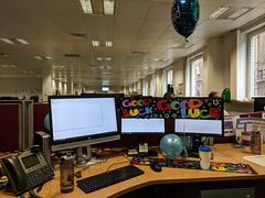 Decorated Leaving Desk (Pyrolytic Carbon) Tags: desk monitors balloons office multiplemonitors tsb phone bottle cup