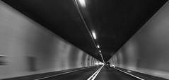 Traversing the Swiss Alps (PeterThoeny) Tags: sanbernardino switzerland tunnel road car monochrome blackandwhite symmetry lines sony a6000 selp1650 1xp raw photomatix hdr qualityhdr qualityhdrphotography sanbernardinotunnel fav100 architecture civilengineering blur
