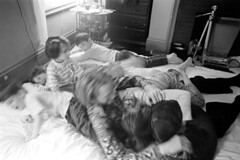 040171 29 (ndpa / s. lundeen, archivist) Tags: nick dewolf nickdewolf blackwhite monochrome blackandwhite 35mm film bw 1971 1970s boston massachusetts beaconhill familyhome 3mtvernonsquare bed man nd family children kids sons daughters siblings twins play playing horsingaround horseplay familytime photographbyalexanderdewolf father dad child boy girl ivan vanessa quentin thalia nicole pet dog animal tuppy tripod boys girls onabed onthebed playingonthebed rollingaroundonthebed may