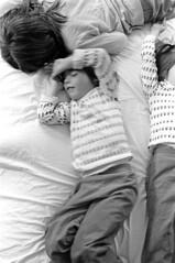 040171 10 (ndpa / s. lundeen, archivist) Tags: nick dewolf nickdewolf blackwhite monochrome blackandwhite 35mm film photographbynickdewolf bw 1971 1970s boston massachusetts beaconhill familyhome 3mtvernonsquare bed play playing horsingaround horseplay familytime girls child girl sisters vanessa nicole thalia onabed onthebed playingonthebed rollingaroundonthebed may