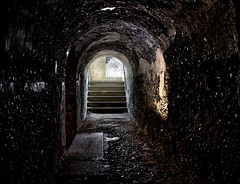 Stone Corridor (95wombat) Tags: old military fortress corridor darkness light shadow decayed crumbling georgesisland fortwarren bostonharbor massachusetts hdr