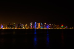 Doha seen from the Corniche Promenade (Tim&Elisa) Tags: doha qatar longexposure reflection water can seascape cityscape city capital colorful corniche promenade nightscape nightphotography