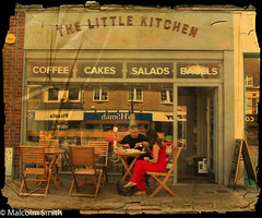 Cafe Life 27 (M C Smith) Tags: eating drinking paper reflection pentax k3 car red tables chairs letters sign pavement shops door open black blue white brick numbers