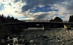 bridge over the white river (Ola 竜) Tags: river stones bridge sky clouds sunlight panorama landscape bluesky darkclouds cloudy highcontrast backlight s7 panoramic skyscape cloud construction urbannature stony rocks water stream dark silhouettes trees bushes weeds plants shadowplay