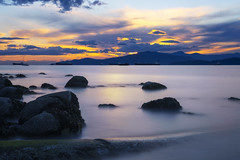 Kits Beach Sunset (Patrick Lundgren) Tags: vancouver columbia canada bc pacific northwest camera sony a7 a7rii full frame long exposure sunset night blue hour clouds sun water cloud sky orange pink red smooth reflection photo beach rocks sea ocean bay rock mountain park landscape tree serene shore kits