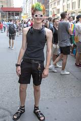 094A2970 v2 (Wheels Down) Tags: gay pride parade 2013 cute twink dyed hair sandals feet legs arms nyc sparkleglasses sunglasses shades prettyboy shoulders rainbow flag headphones tanktop adorable