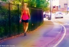 Sunday Run 2 (M C Smith) Tags: woman pentax k3 jogging pavement road traffic lines kerb dream railings black trees green leaves trafficlights buildings purple blonde phone litterbins lamps car