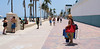 Red Tote (Andy Zito) Tags: bright red beach tote bag cowgirl cowboy hat walking young lady carrying chair blanket broadwalk boardwalk folks goers scene sand ocean palm trees hollywood south florida