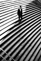 Between two steps (pascalcolin1) Tags: paris bastille homme man marches steps escalier staircase soleil sun lumière light ombre shadows photoderue streetview urbanarte noiretblanc blackandwhite photopascalcolin 50mm canon50mm canon