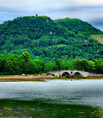 Scotland West Highlands Argyll The Watch Tower and Inveraray Bridge if you see any murdering English ring the bell 7 July 2018 by Anne MacKay (Anne MacKay images of interest & wonder) Tags: scotland west highlands argyll sea coast watch tower inveraray bridge landscape trees mountain xs1 7 july 2018 picture by anne mackay