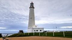 Cabo Santa María (Raúl Alejandro Rodríguez) Tags: faro lighthouse cabo cape nubes clouds mar sea bandera flag santa maría la paloma rocha república oriental del uruguay