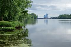 Grand River (danielhast) Tags: grandrapids michigan grandriver riversidepark river water sky building tree reflection