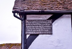 Notice is hereby given...... (rustyruth1959) Tags: grass guttering fallpipe rooftiles tiles roof white wood board vagrants notice writing text beams oldbuilding oldtown building oldsign sign wickham hampshire england uk tamron16300mm nikond5600 nikon