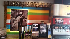 Hurts Donut Company - Springfield, Missouri (Adventurer Dustin Holmes) Tags: hurtsdonuts hurtsdonut springfield midwest dining dessert springfieldmo missouri ozarks greenecounty route66 us66 missouri66 indoor food placestoeat creammachine sodafountain drinks beverages coffee cocacola coke softdrinks carbonatedbeverages drpepper picture photo photograph kissing sailor wwii worldwarii lemonade ronnoco fantaorange sprite barqs sign restaurant colorful stripes makingout leaningback bendingover kissingpassionately kissingwithpassion whitedress dress