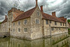 Ightham Mote and moat (Geoff Henson) Tags: manor fort house medieval mote moat water reflection building plants sky clouds chimneys tower bridge