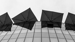 Sunny Day in Vienna (Leipzig_trifft_Wien) Tags: wien österreich at sun sunny parasol sunprotection facade glas mirror reflection architecture black white grey bnw monochrome city urban building curve lines geometry