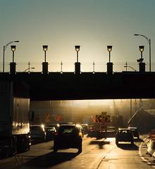 sunset drive on Decarie Boulevard (marianna_a.) Tags: p2290708 decarie montreal highway sunset lights fence overpass urban city metropolitan drive cars canada marianna armata