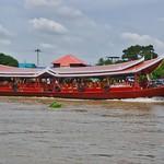 Tour boat passing Koh Kret island on the Chao Phraya river near Bangkok, Thailand thumbnail