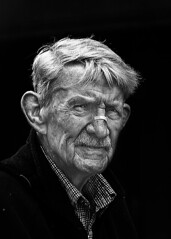 Portrait (D80_509110) (Itzick) Tags: denmark copenhagen candid bw bwportrait portrait mustache bandaid man face facialexpression d800 itzick streetphotography blackbackground
